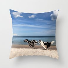 Playing dogs at the beach Throw Pillow