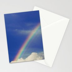 Rainbow over fluffy white clouds in the blue sky Stationery Cards