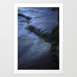 Sparkling Blue Water Slips Past Gnarled Tree Roots Art Print
