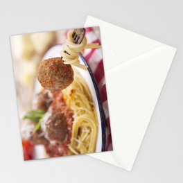 Spaghetti and meatball on a fork, plate in the background Stationery Cards