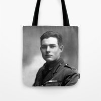 hemingway Tote Bags featuring Ernest Hemingway in Uniform, 1918 by Limitless Design