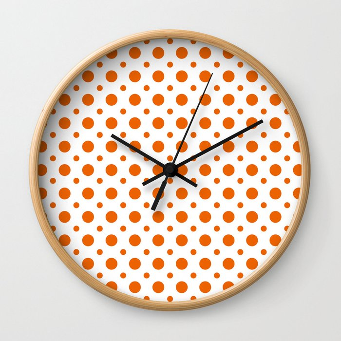 Bright orange and white polka dots pattern Wall Clock