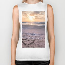 Love note Te Amo with the heart drawing on the beach at sunrise Biker Tank