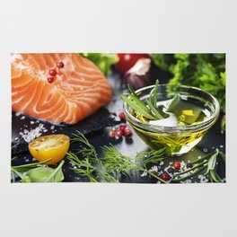 Delicious  portion of fresh salmon fillet  with aromatic herbs, spices and vegetables Rug