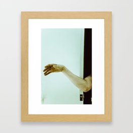 reaching out. Framed Art Print