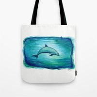 psychadelic Tote Bags featuring Indigo Lagoon ~ Dolphin Watercolor by Amber Marine
