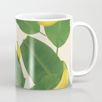 banana leaf Mugs featuring banana by aisyrahma
