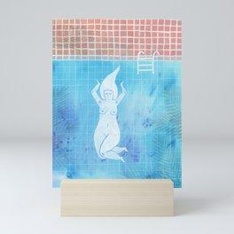 Woman skinny dipping in a pool Mini Art Print