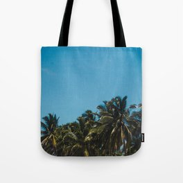 Vibrant blue skies above palm trees in Costa Rica during summer Tote Bag