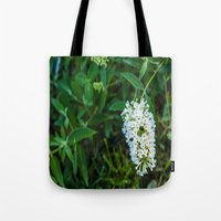 rileigh smirl Tote Bags featuring Daisies by Rileigh Smirl