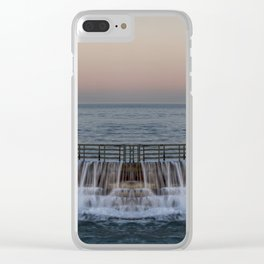 A reflected panorama of a seawall as a wave washes over it in La Jolla, San Diego, California Clear iPhone Case