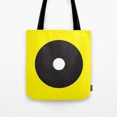White dot on black on yellow Tote Bag