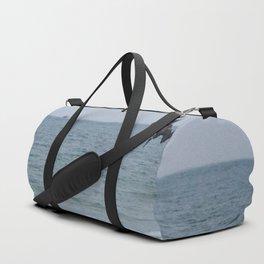 Diving for fish Duffle Bag