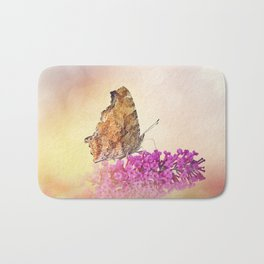 Butterfly feeds on flowers in the garden Bath Mat