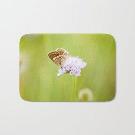 Butterfly on a flower Bath Mat