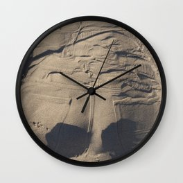 Jeans in sand Wall Clock