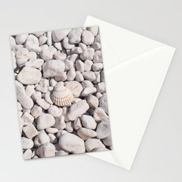 A seashell on white stones Stationery Cards