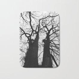 two tall winter beech trees Bath Mat