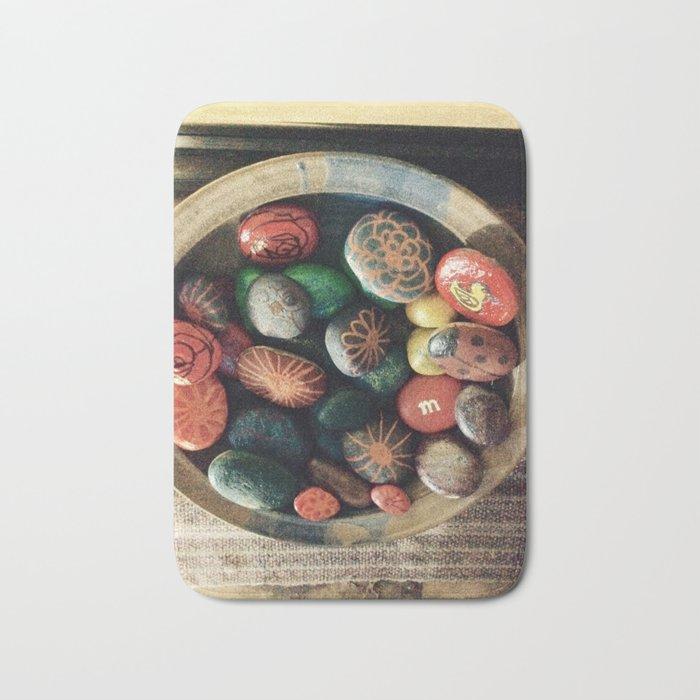Rock art in ceramic bowl Bath Mat