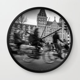 Cyclists ride in Amsterdam street in front of the Rijksmuseum Wall Clock