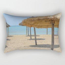 Parasols in a row on a sunny beach Rectangular Pillow