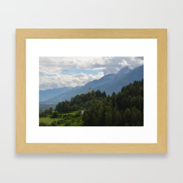 A glimpse through the forest Framed Art Print