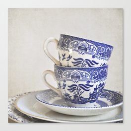 Blue and white stacked china. Canvas Print