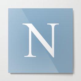 Letter N sign on placid blue background Metal Print