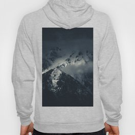 Darkness and clouds over the mountains Hoody