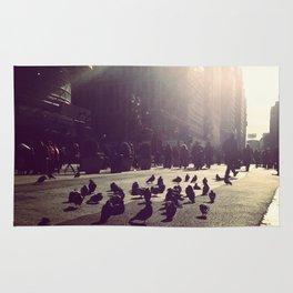 times square sun birds Rug