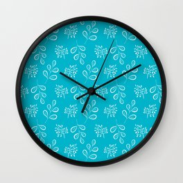 White laves on a  blue Wall Clock