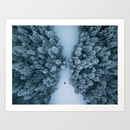Man lying in the snow on a frozen lake in a winter forest - Landscape Photography Art Print