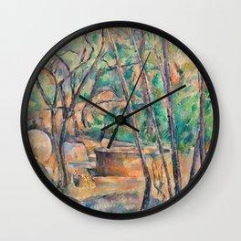 Paul Cézanne - Millstone and Cistern under Trees Wall Clock