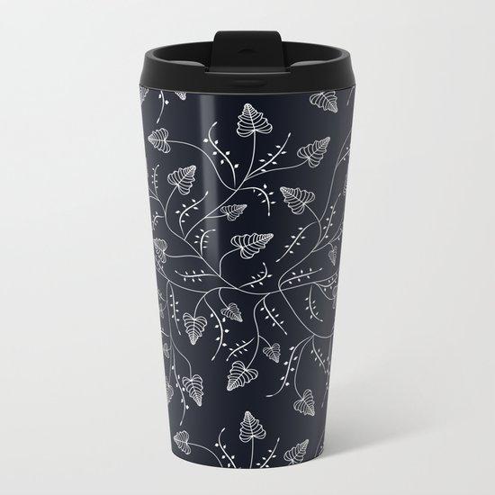 Delicate leaves on a black background . Metal Travel Mug