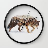 andreas preis Wall Clocks featuring Arctic Wolf by Andreas Lie
