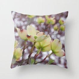 yellow dogwood flowers on black maple bokeh Throw Pillow