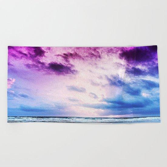 Cloudy shores Beach Towel