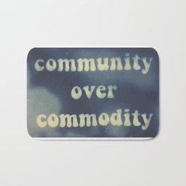 community over commodity Bath Mat