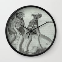 manatee Wall Clocks featuring Monkey Manatee  by monstersneedlove