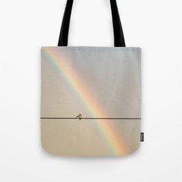 songbird preening under a rainbow (vertical Tote Bag