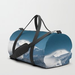 Misty clouds over snowy mountain Snežnik, Slovenia Duffle Bag