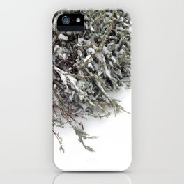Christmas tree lying down on white snow iPhone Case
