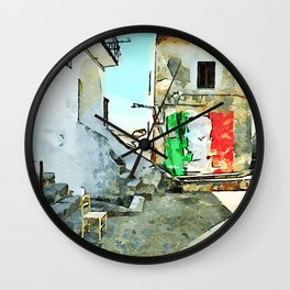 Tortora glimpse with chair and building whit Italian flag painted on the wall Wall Clock