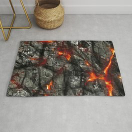 Fiery lava glowing through dark melting stone Rug