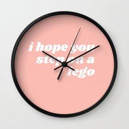 step on a leggo Wall Clock
