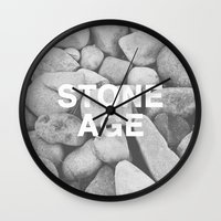 queens of the stone age Wall Clocks featuring Stone Age by Concept Phi