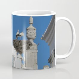 storks build nests on the church in the old town of faro, portugal, europe Coffee Mug