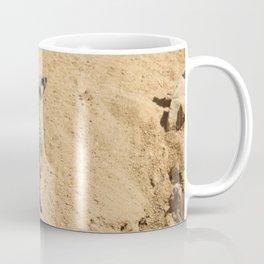 Little suricate looks around Coffee Mug