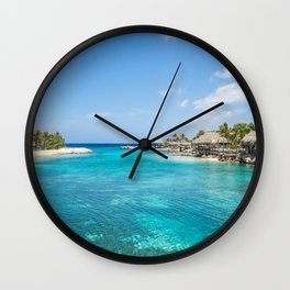 Blue water lake with huts and palm trees around Wall Clock