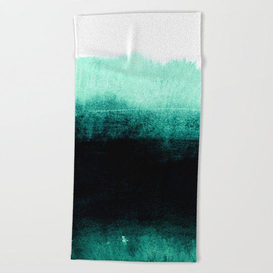 into the deep green Beach Towel